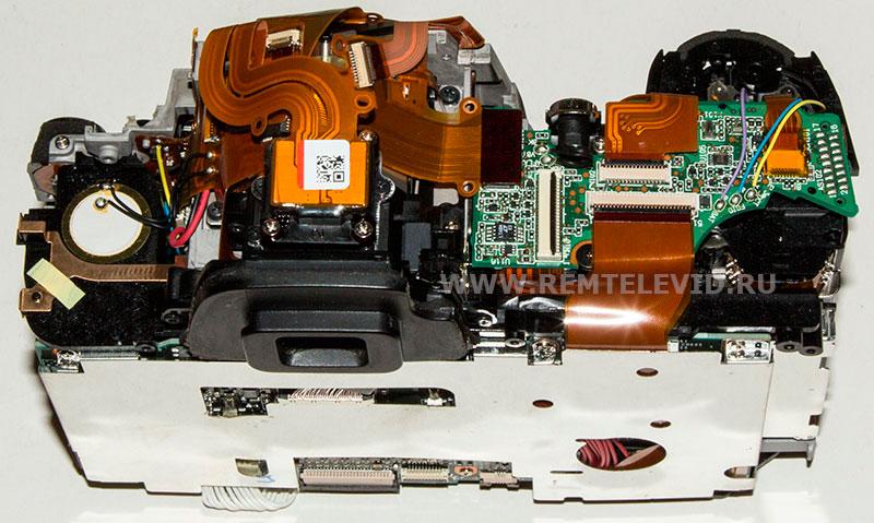 Конструкция зеркального фотоаппарат никон д300 со снятой верхней панелью.