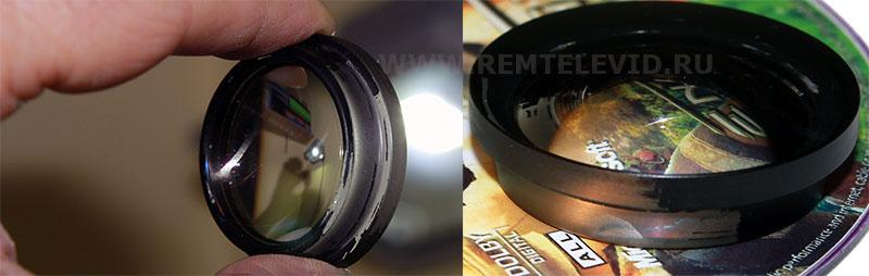Внешний вид демонтированной из оправы передней линзы объектива Nikon 18-55 mm